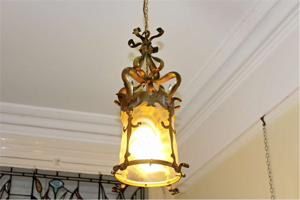 Quality brass arts and crafts lantern with original glass shade possibly by Powell