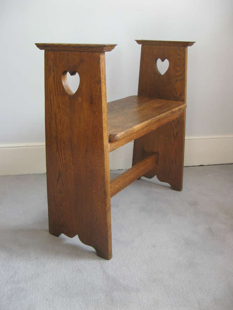 Arts and Crafts oak window seat with pierced heart cut outs