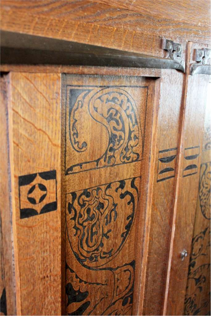 arts and crafts oak cupboard with wonderful metalwork and stencilled decoration
