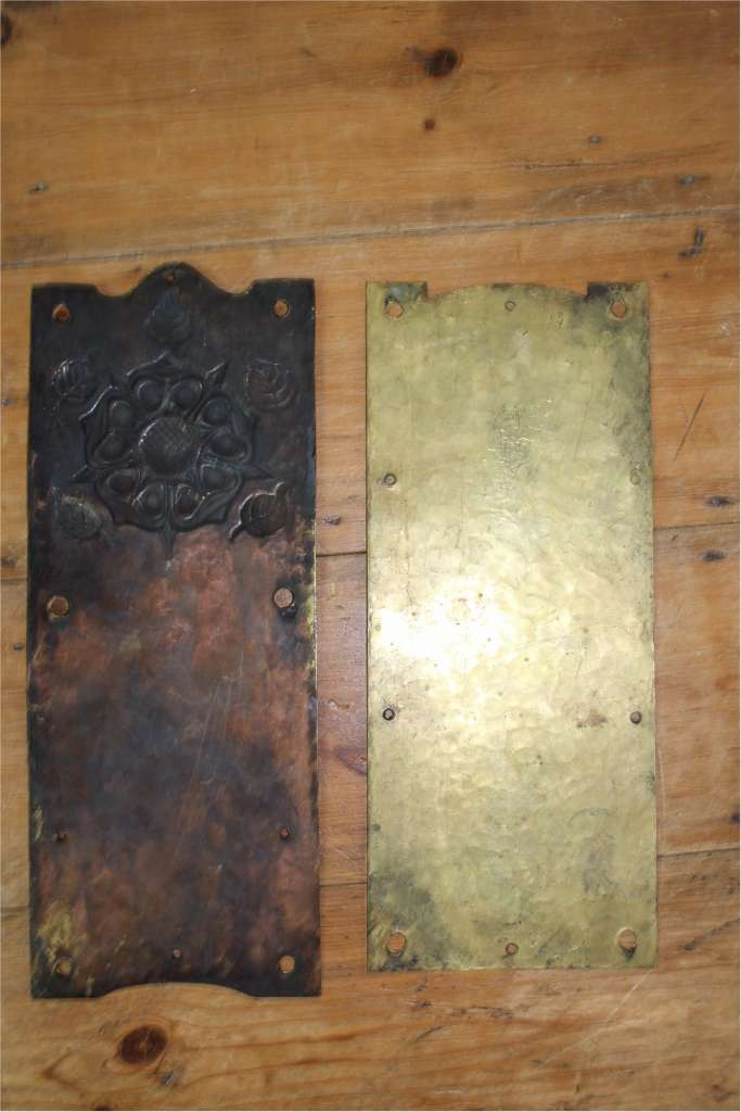 Pair of arts and crafts brass finger plates