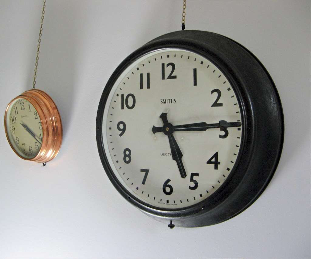 Large Smiths Sectric black metal framed electric wall clock from factory or public building