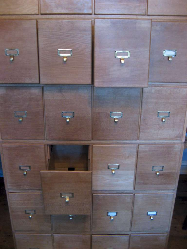 Oak sectional filing cabinet with brass pulls