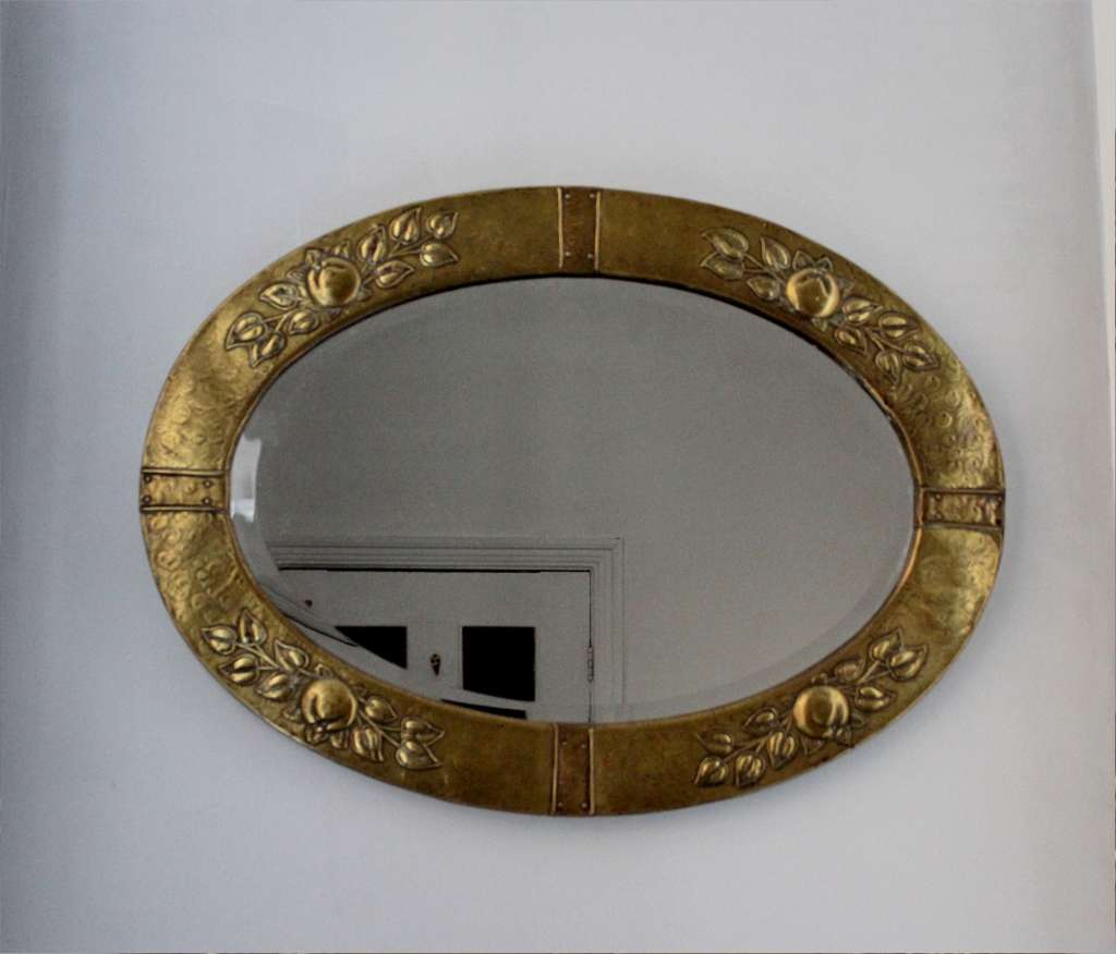 Arts and Crafts brass wall mirror