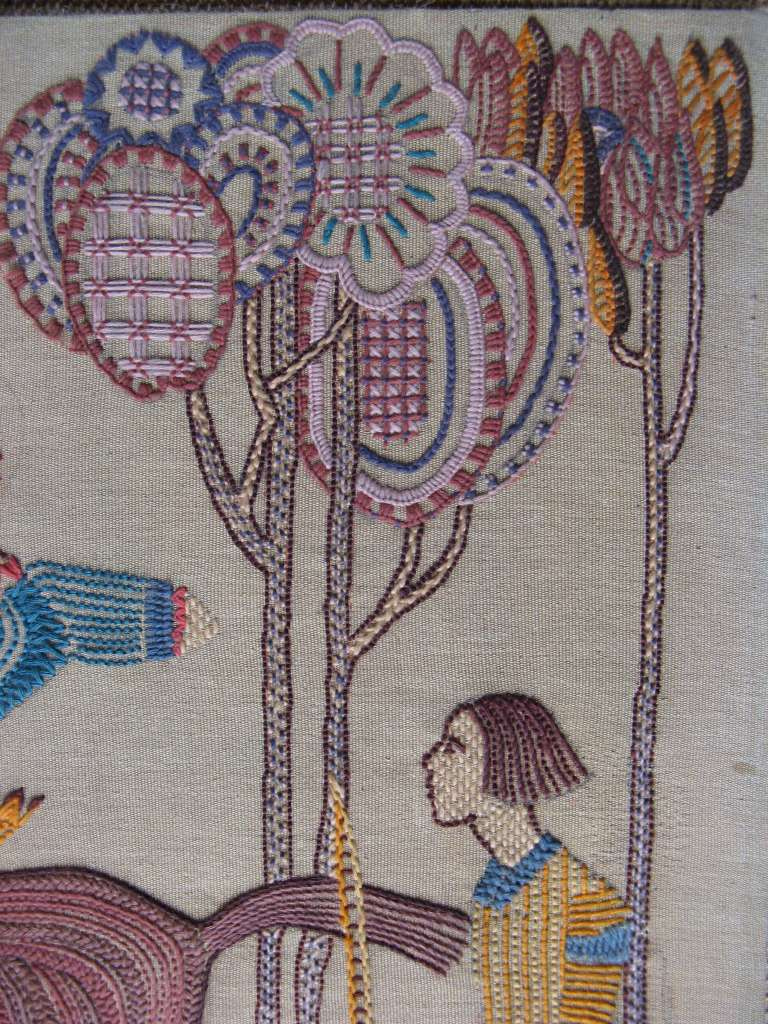 Stylised 1930's embroidery of huntsmen