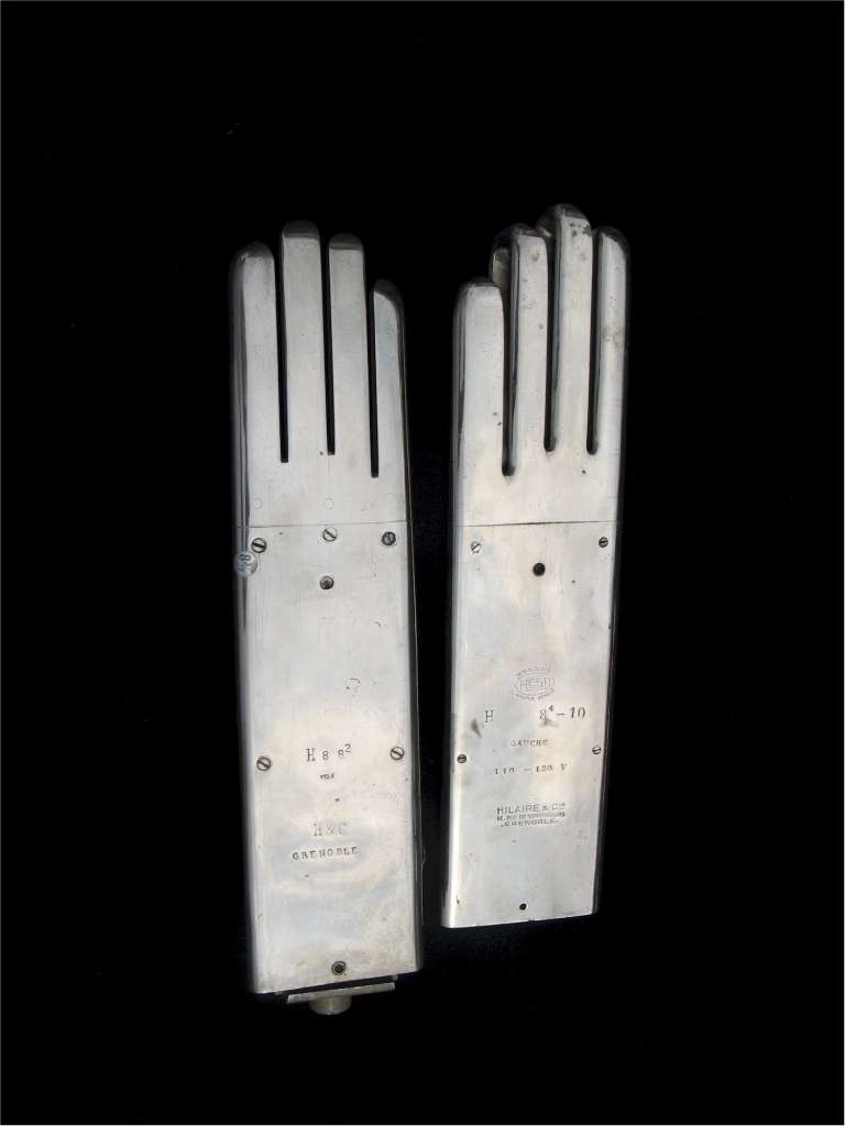 Interesting factory heat moulds in chrome for gloves by Hilaire of Grenoble