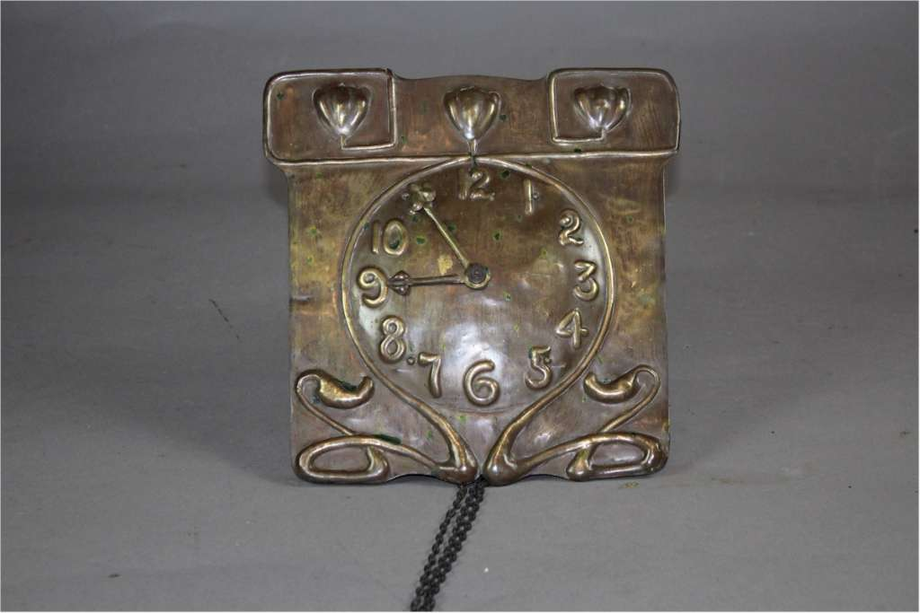 Brass arts and crafts wall clock c1900