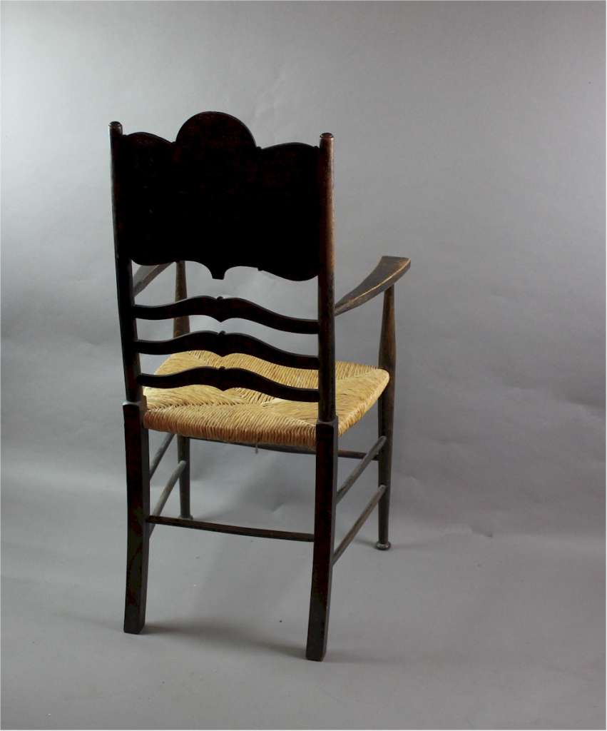 Arts and Crafts elbow chair with rush seat.