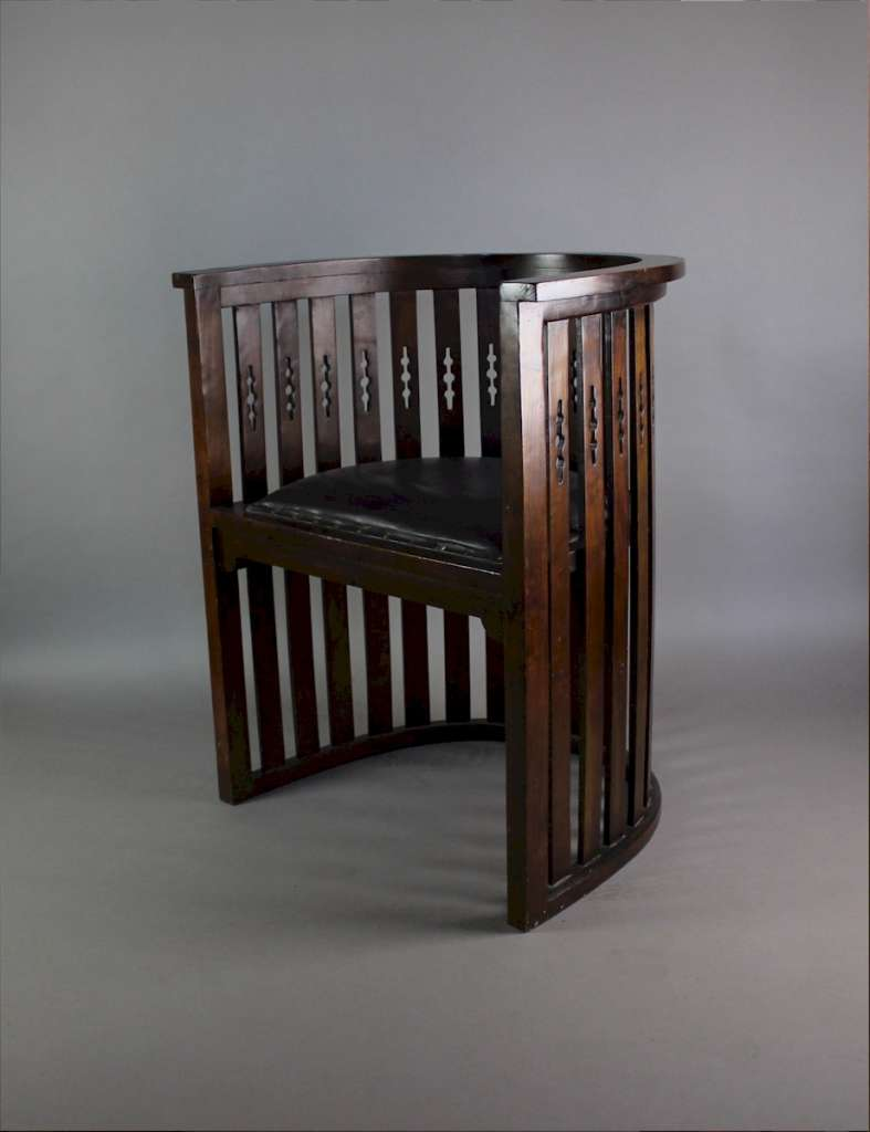 Arts and Crafts mahogany barrel chair with pierced cutouts. c1910