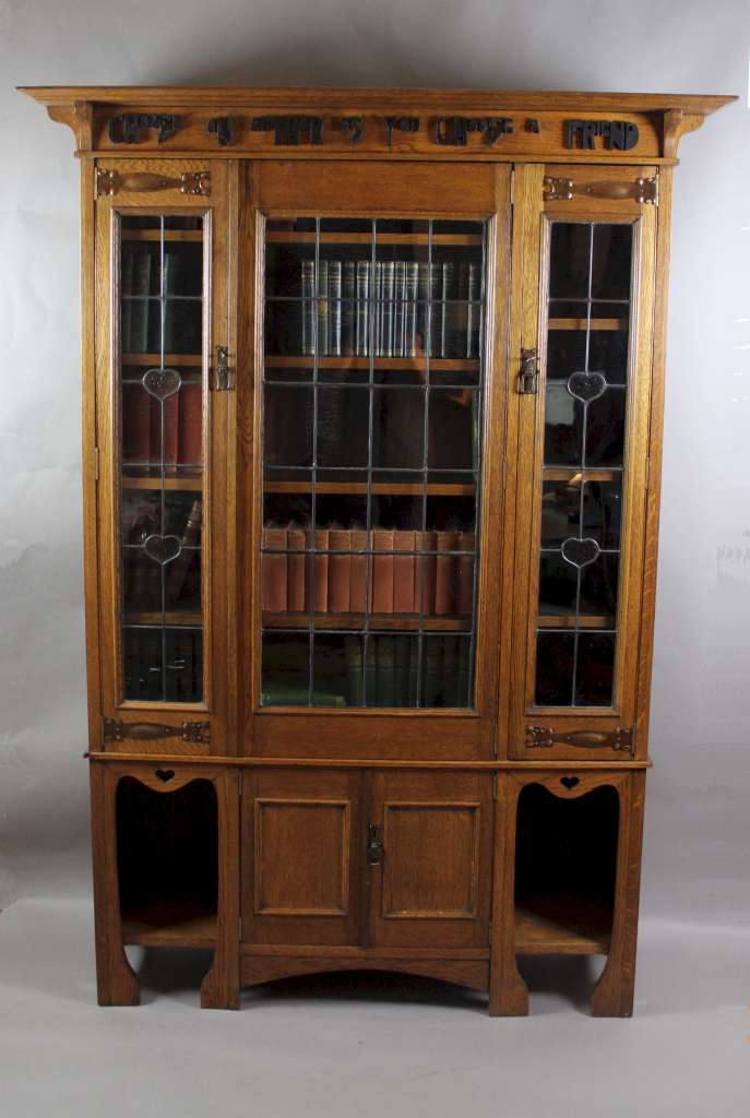 Arts and Crafts oak glazed bookcase with Motto,