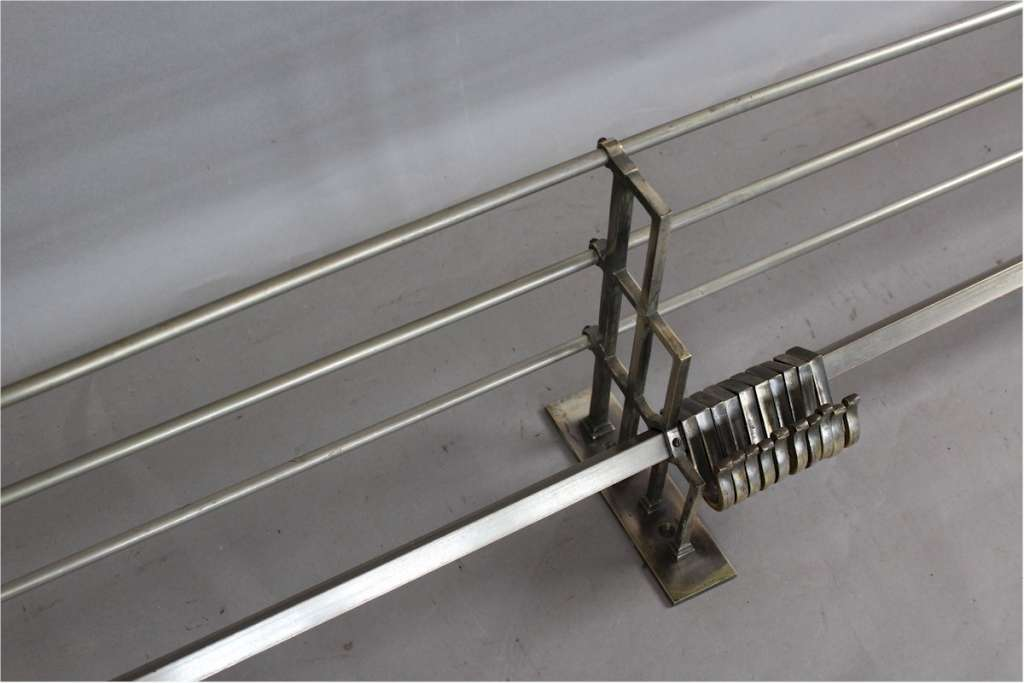 Art Deco nickel plated hat rack with twenty hooks. C1940