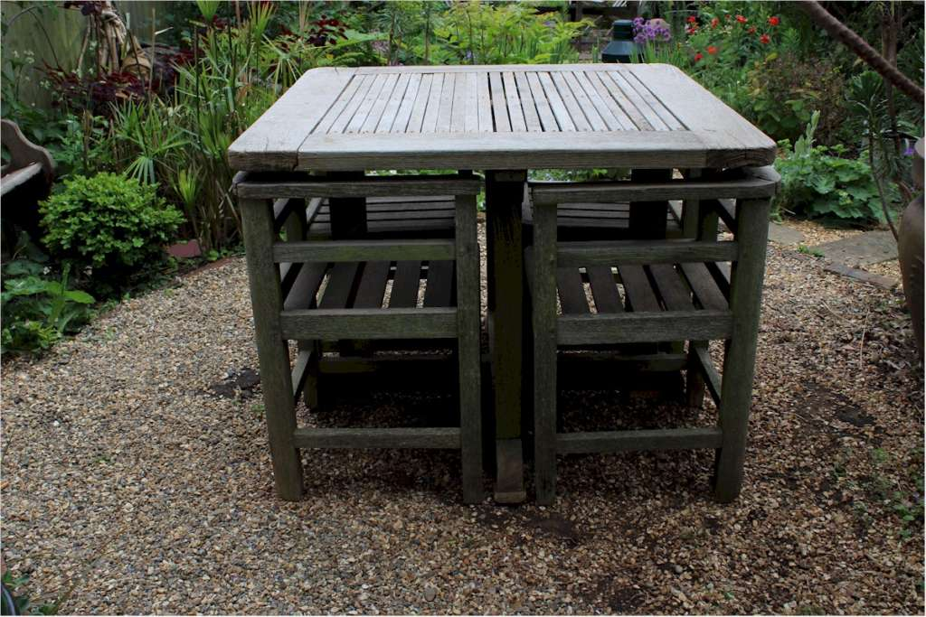 Weathered teak garden set retailed through Heals