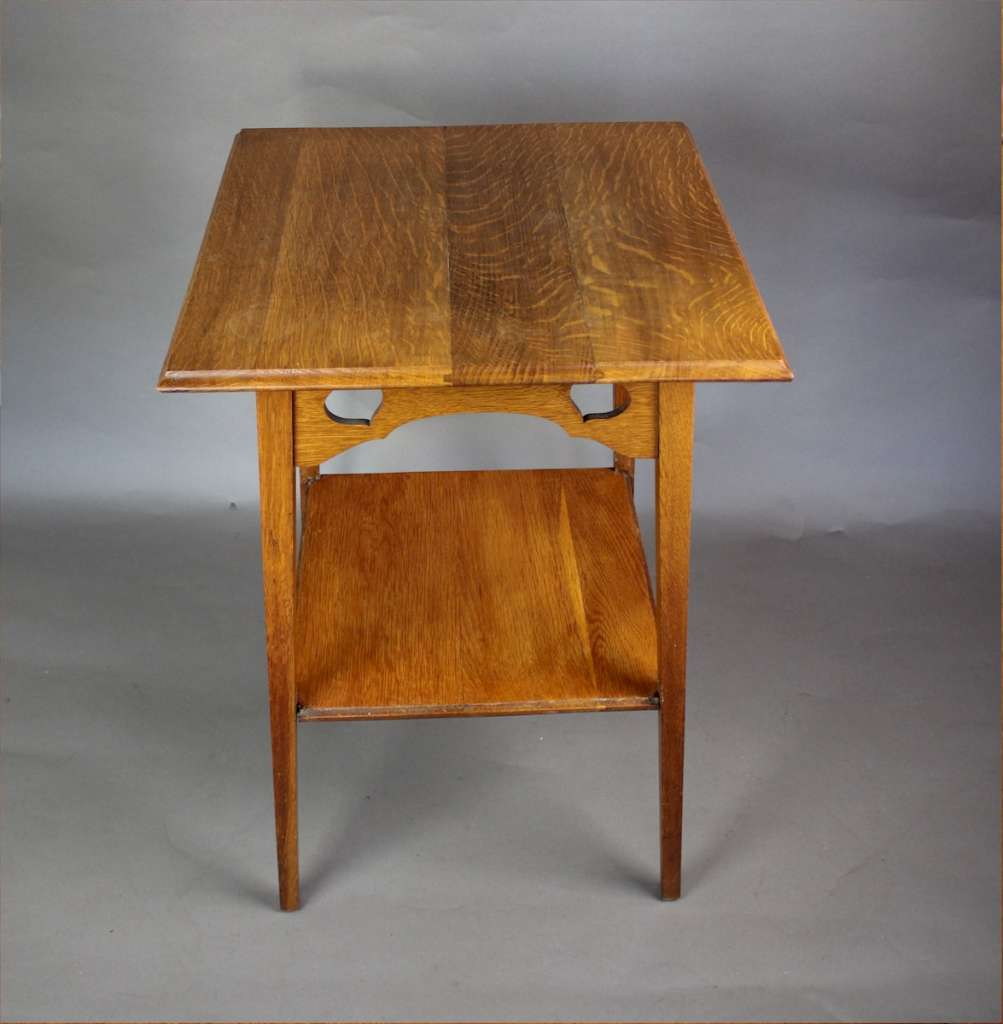 Arts and crafts golden oak heart cut out occasional table. c1900