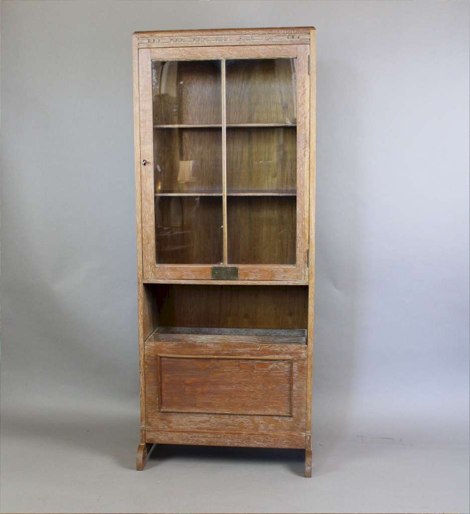 1930's limed oak glazed bookcase with interesting fall front magazine rack. Probably by Heals