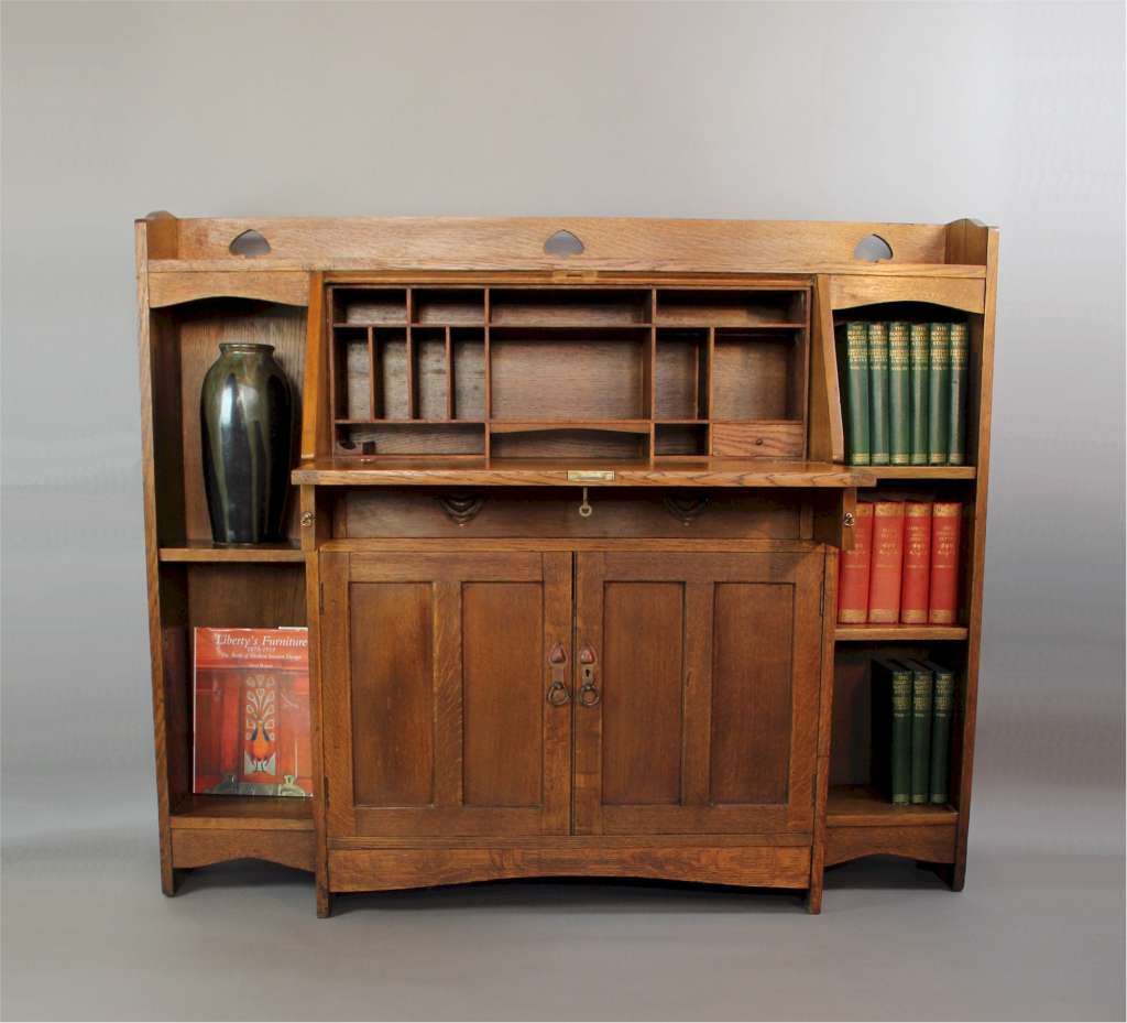 Liberty & Co arts and crafts oak bureau bookcase with pierced heart cut outs