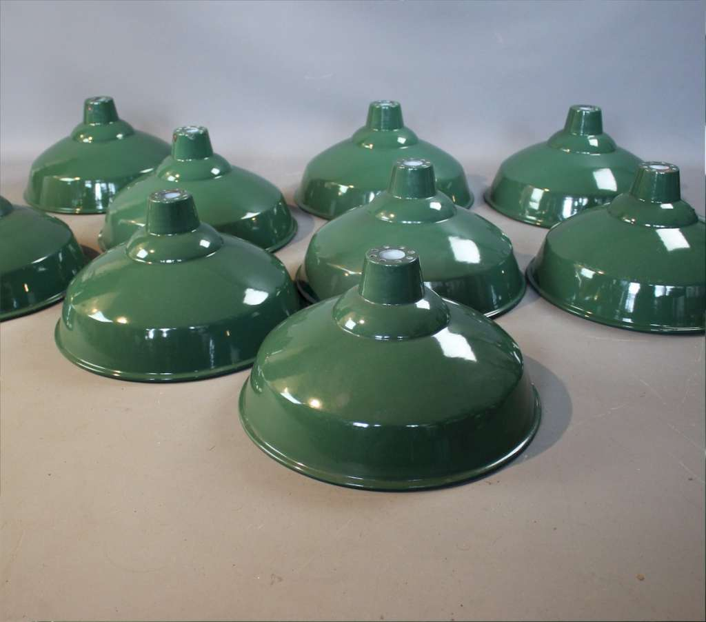 Quantity of original green enamelled industrial shades.