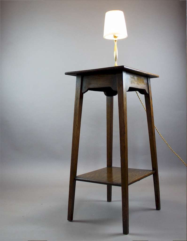 Oak side / lamp table from the arts and crafts period