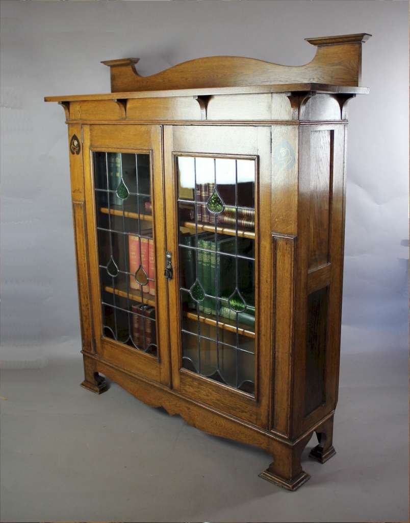 Arts and Crafts oak bookcase with pewter and ebony inlay