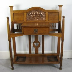 Arts and Crafts hall stick stand in oak with copper panel by Shapland and Petter of Barnstaple