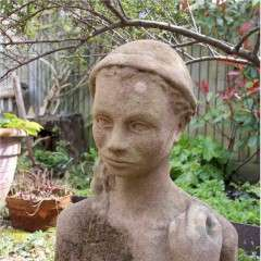 Garden statue in sandstone of an Island girl