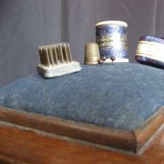 Oak arts and crafts period sewing box with pin cushion top.