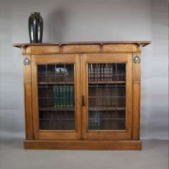 Arts and Crafts bookcase with leaded doors and ebony / Pewter inlay c1900