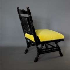Aesthetic Movement Ebonised fireside chair.