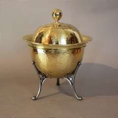 Arts and Crafts brass coal scuttle on iron legs