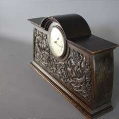 Arts and crafts carved oak mantle clock