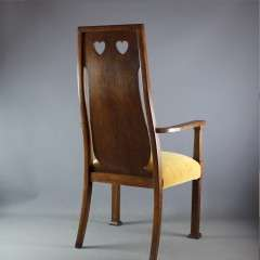 Arts and crafts oak carver chair by Goodyers.