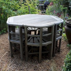 Rare teak garden set of table and six wrap round chairs retailed by Heals made by Hughes Bolckow