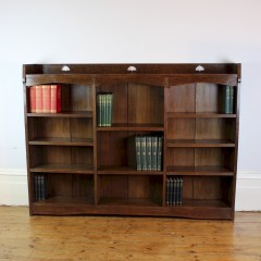 Liberty & Co Arts and Crafts oak open bookcase with pierced heart cut outs
