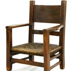 An Arts and Crafts oak 'mission' armchair,with a woven string seat