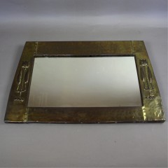 Arts and Crafts / Nouveau brass mirror with raised stylised tulip