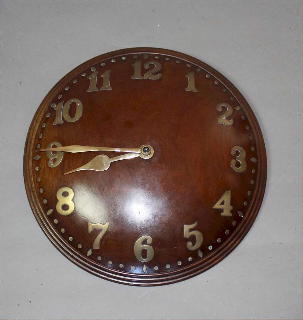 1930's concave  wall clock in walnut with  brass numerals, by Zenith